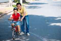 Learning to ride a bike Royalty Free Stock Image