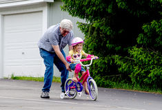 Learning to ride a bike stock photos
