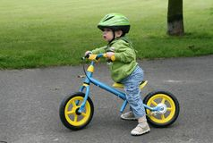 Learning to ride on a first bike Royalty Free Stock Images