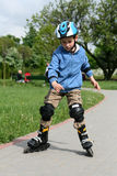 Learning to ride on rollerblades Stock Photos