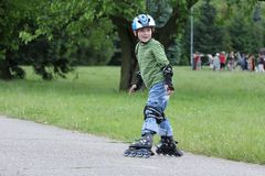 Learning to ride on rollerblades stock images