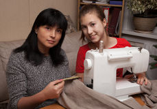 Learning to sew Stock Photo