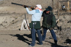Learning to Shoot. Teenage girl learning to shoot sporting clays from her grandfather Royalty Free Stock Photography