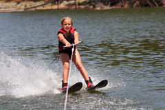 Learning to Ski. Girl learning to water ski Stock Images