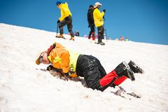 Learning to slip properly on a slope or glacier with an ice ax Stock Image