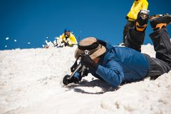 Learning to slip properly on a slope or glacier with an ice ax Royalty Free Stock Photography
