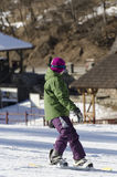 Learning to snowboard royalty free stock photo