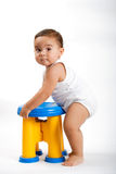 Learning to stand up. Baby girl learning to stand up Royalty Free Stock Photo