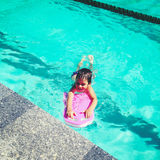 Learning to swim. Happy boy learning to swim Stock Photos
