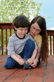 Learning to tie shoes Stock Photos