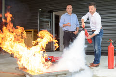 Learning to use fire extinguisher. Learning to use the fire extinguisher royalty free stock photo