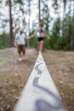 Learning to walk on a tightrope, and keep the balance. Royalty Free Stock Photo