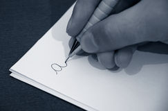 Learning to write. Child learning to write the A letter Stock Photo