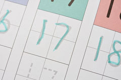 Learning to write numbers. Child writes on guide learning to write numbers Royalty Free Stock Photos