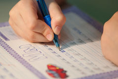 Learning to write. In the school Royalty Free Stock Photo