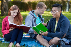 Learning together in a park Royalty Free Stock Photo