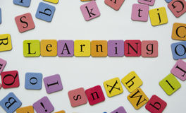 Learning. Toy magnetic letters spelling the word Learning Royalty Free Stock Photos