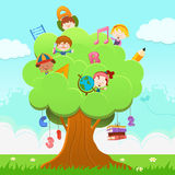 Learning Tree. Little children climbing on a tree with school objects Royalty Free Stock Photography