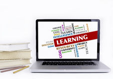 Learning - word cloud, education concept. Laptop and books isolated on white background royalty free stock images