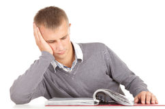 Learning young male student. With file binder Royalty Free Stock Photos