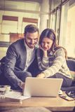 Learning from your older colleagues. Close up image of two business people Royalty Free Stock Photography