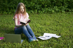Learns in the park. The student learns in the park royalty free stock photography