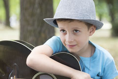 He learns to play guitar Stock Photography