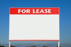 For Lease. Sign against a neutral brick wall Stock Photo