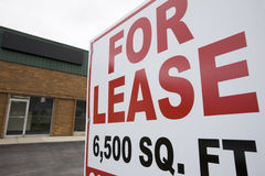 For lease. Sign at small strip shopping center Royalty Free Stock Images