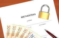 Lease agreement. German lease agreement with padlock in a studio shot Stock Photo
