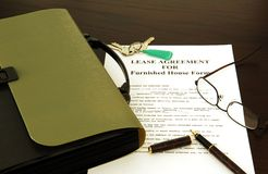 Lease agreement. Keys' glasses and papers Royalty Free Stock Image