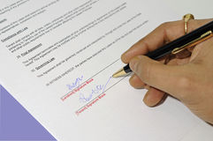 Lease agreement being signed. Important legal lease agreement document being signed with a pen Royalty Free Stock Photography