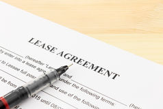 Lease Agreement Contract Document and Pen Bottom Left Corner Stock Photo