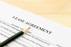Lease Agreement Contract Document and Pencil Bottom Left Corner. On Wood Table. Legal document for business event Royalty Free Stock Photo