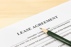 Lease Agreement Contract Document and Pencil at Bottom Right Corner Stock Image