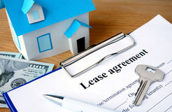Lease agreement document with home model. Stock Photography