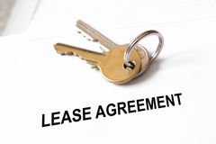 Lease agreement. Document with house keys Royalty Free Stock Photography
