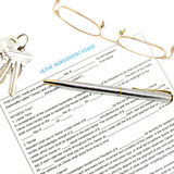Lease agreement document with key Stock Photos