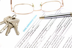 Lease agreement document with key Royalty Free Stock Image