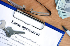 Lease agreement document with money Royalty Free Stock Photo