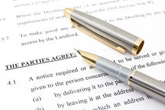 Lease agreement and pen. Showing real estate concept Royalty Free Stock Photo