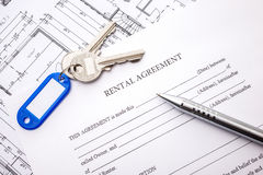 Lease agreement. Rental agreement document with keys and pencil Royalty Free Stock Photo