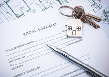 Lease agreement. Rental agreement document with keys and pencil Stock Image