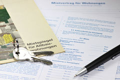 Lease contract. German lease contract with rent index on desktop Royalty Free Stock Images