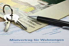 Lease contract. German lease contract with rent index on desktop Stock Image