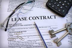Lease contract with keys and glasses. Close-up Royalty Free Stock Photo