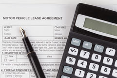 Lease Document Agreement with calculator Stock Images