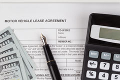 Lease Document Agreement with calculator Stock Photo