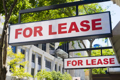 For Lease signs on display outside buildings. Two For Lease signs on display outside buildings during daytime Stock Photos