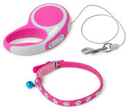 Leash for dog with collar. Pink retractable leash for dog and jeweled collar with bell isolated on white background Stock Images